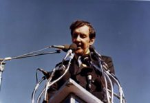 U.S. Senator Edmund Muskie, author of the 1970 Clean Air Act, addressing an estimated 40,000-60,000 people as keynote speaker for Earth Day in Fairmount Park, Philadelphia on April 22, 1970. The image on the podium was the official logo of the first Earth Week. Photo: Wikimedia, CC.