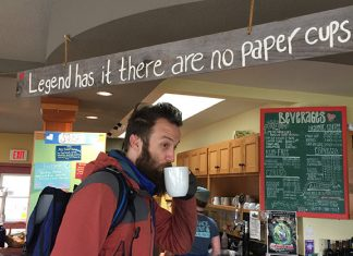 A customer at the Beachcomber Cafe uses a reusable mug to reduce waste. Photo: Emma Held.