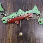 Metal salmon hanging coat rack.