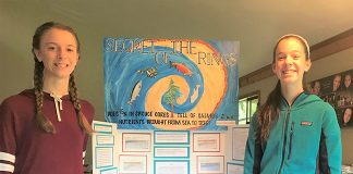 Anneli and Mathilde Macdonald, 8th graders at Jacoby Creek School, stand in front of their first-place project about nitrogen isotopes in tree rings. Photo: courtesy of Sierra Club.