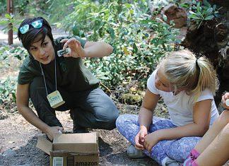 Jemma teaching kids about macroinvertebrates at Bothe Nature Camp (Napa Resource Conservation District). Photo courtesy of Jemma Williams.