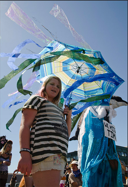 Girl with jellyfish umbrella from the 2011 All Species Parade. Photo: Mark Larson.
