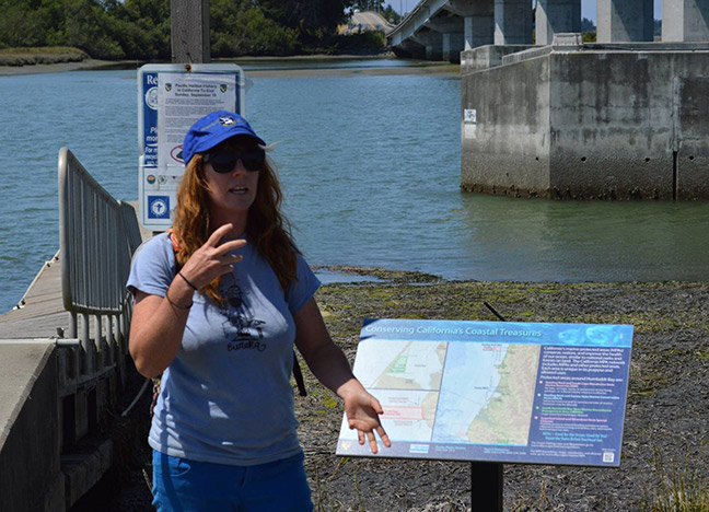 Bay Tours Coordinator Jasmin Segura recently led a tour of the newest section of Eureka's Waterfont Trail for English Express students and their families. This trail is part of the California Coastal Trail, which will eventually stretch the entire length of the state. Photo by Mary Ann Hytken, English Express.