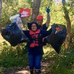 Volunteers from Coast Seafoods clean up Palco Marsh. Photo: Joe McKenzie.