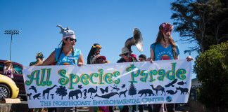 Casey Cruishchank and Megan Bunday carry the NEC banner in the All Species Parade. Photo: Adam Taylor.