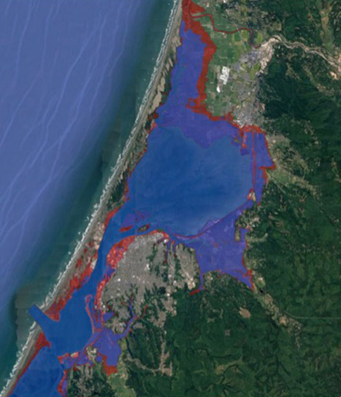 Graphic illustrates the area of Humboldt Bay that is vulnerable if shoreline barrier structures such as dikes are compromised by king tides (blue regions) versus potential tidal inundation area with two meters of sea level rise (red). Graphic: Aldaron Laird.