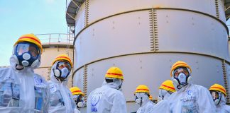 A team of IAEA experts check out water storage tanks TEPCO's Fukushima Daiichi Nuclear Power Station on 27 November 2013. The expert team is assessing Japanese efforts to decommission the stricken nuclear power plant. Photo Credit: Greg Webb / IAEA