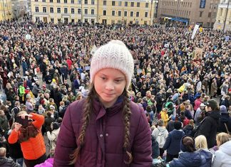 Greta Thunberg, above left, after addressing 10,000 people in Helsinki, October 20, 2018, at the largest climate march in Finland's history. Photo: Svante Thunberg (Greta's father) via Twitter.